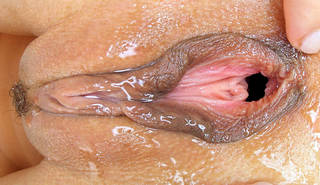 Wet sexy vaginal hole closeup.